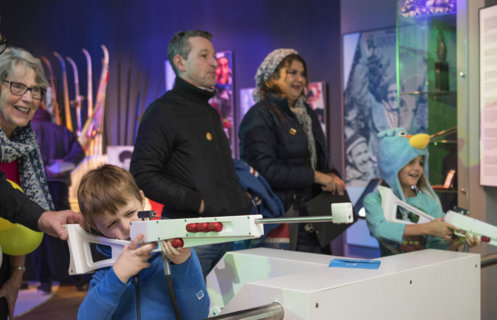 Children and adults trying the biathlon simulator.